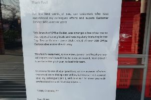 The message in the window of the Horsham town centre branch of Office Outlet