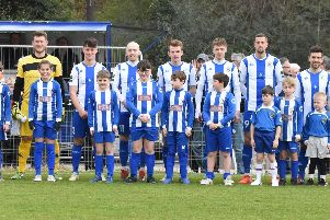 Haywards Heath Town's team and mascots line-up before kick-off.'Picture by Grahame Lehkyj