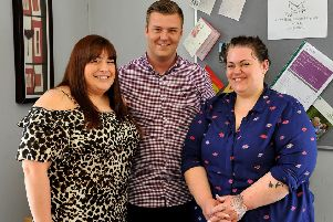 Scott McLeod and staff members Debbie Lyons and Victoria Wright. Photo by Steve Robards