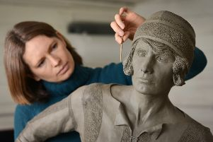 Sculptor Hannah Stewart with her bronze of pioneering footballer Lily Parr SUS-191005-151816001