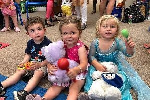(From left) Ollie Higson, Lola Burrell and Maisie Hinkins, all two, at the 'Rhyme Time' session at Burgess Hill Library