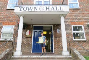 Eddie Barker with his poster outside Haywards Heath Town Hall
