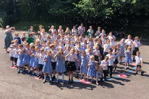 St Peter's C Of E Primary School pupils and staff celebrating the Ofsted result