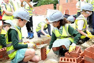 Some of the students prepping the bricks to build their wall