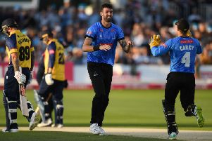 Alex Carey runs to congratulate Reece Topley after Sussex take the first Essex wicket, getting rid of Cameron Delport / Picture: Getty Images