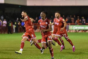 Crawley Town players celebrate against Stoke City