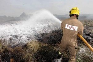 A firefighter tackling a gorse fire (file pic)