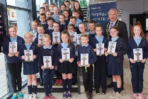 Councillor Sean McPeake Chair of Mid Ulster District Council meets with pupils from St. Patricks Primary School, Mullinahoe at the animation project launch.