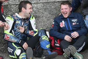 William Dunlop and his cousin Gary share a joke at the Classic TT in 2017.