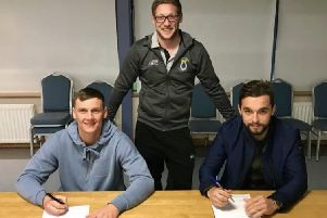 Dungannon Swifts manager Kris Lindsay pictured with his new club captain, Christopher Hegarty and vice-captain, Seanan Clucas, who have both signed contract extensions.