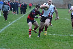 Andrew Willis charges in for a try as Armagh defeat Rainey