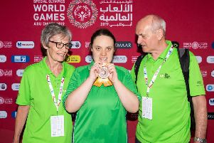 Emma Carlisle from Ballygowan won Bronze in the 100m backstroke, and was the firstIrish Athlete to get a medal. Emma is pictured with her Mum and Dad. Photo: Ricardo Guglielminotti /Special Olympics Ireland.