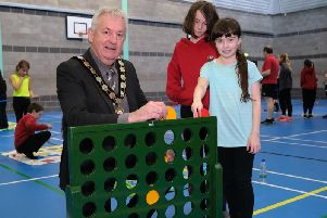 Chair of Mid Ulster District Council, Councillor Sean McPeake tests out the newly refurbished Maghera Leisure Centre Main Hall, along with local primary school children who were among the first to try the new facilities.