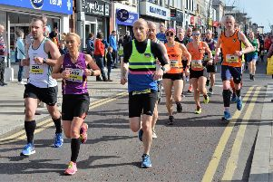 Runners make their way along Main Street during the Larne half-marathon. INLT 11-002-PSB