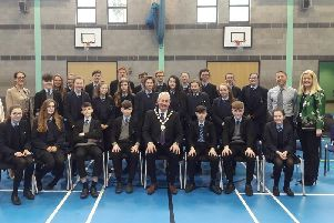 Chair of Mid Ulster District Council, Councillor Sean McPeake pictured with Council officers, pupils and staff from St. Patrick's College, Maghera Primary School and St. Mary's Glenview Primary School at the recent Maghera Public Realm Information Session.