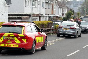 ye ''Emergency services assess the scene of a house fire in Millburn Avenue, Cookstown