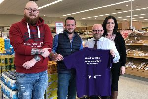 Tony Devin Store Manager of Newells Coalisland and Gary ONeill owner of V&S Bouncy Castles sponsors of the Niamh Louise Foundation walk & Talk event receiving an event T-shirt from Foundation Committee members Sam Benson and Fionuala Hughes.