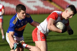 Derry's Shane McGuigan powers past Tipperary player Robbie Kiely in Celtic Park on Sunday. DER0720-103KM