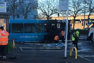 The fire damaged bus at Bletchley Bus Station