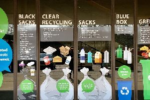 Windows at MK Council's offices get across the recycling message