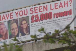 Banner offering 5,000 reward for information on Leah Croucher's disappearance
