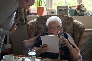 Marjorie opening her letter from the Queen