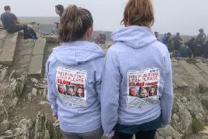 Jade Croucher and friend with hoodies emblazoned with Leah's 'missing' poster