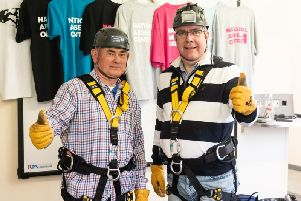 Phil Blacklaw (left) and Hugh Douglas Smith prepare for their abseil