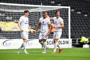 Sam Nombe celebrates with Alex Gilbey and Conor McGrandles