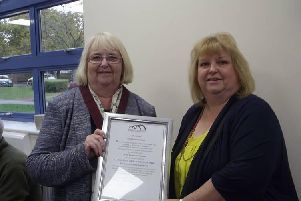 Kevin's wife pictured accepting the award from Cllr Sue Smith, leader of Woughton Community Council