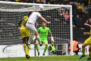 Dean Lewington goes got goal with a header during MK Dons' 3-0 defeat to Burton Albion (Pictures: Jane Russell)