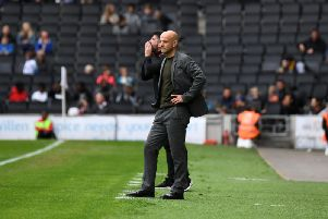 Paul Tisdale watches his side during their 3-0 defeat at the hands of Burton Albion on Saturday (Picture: Jane Russell)