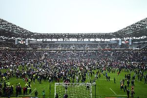 Fans invade the pitch after the Sky Bet League Two match between Milton Keynes Dons and Mansfield Town at Stadium mk on May 04, 2019 in Milton Keynes, United Kingdom. (Photo by Bryn Lennon/Getty Images)
