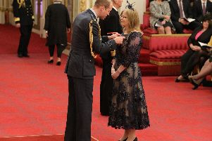 Dr Mills receives the honour from Prince William at Buckingham Palace