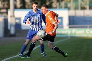 Newry City's Mark McCabe (Blue & White Stripes) headed home a late winner at Institute, on Saturday.