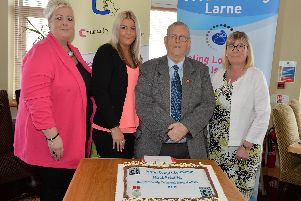 Matt Ritchie is pictured with his daughters Lois, Melissa and Lucinda at an awards lunch in the Curran Court Hotel in recognition of his dedication and commitment to the Good Morning Larne project. INLT 24-003-PSB
