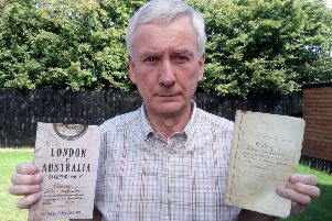 Retired university professor Brian Jennings with a copy of 'London to Australia By Clipper 1886 - 87' and the diary of his great-great-uncle John Ferguson, which he edited to create the book.
