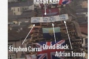 The names of Adrian Ismay, David Black, Ronan Kerr and Stephen Carroll on the Bogside bonfire