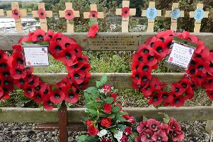 The poppy wreaths were replaced within hours of Saturday's attack