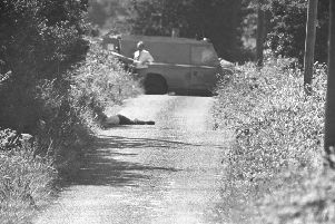 Around 70 alleged agents were identified and shot dead 'by brutal men in horrible circumstances, then ditched to dehumanise them'. Above, the body of Brian McNally, an alleged IRA informer from Warrenpoint, killed and dumped on the border in 1984. Picture Pacemaker