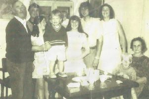 Geraldine O'Reilly, 15, in the centre of this picture with her family smiling at the camera, was murdered not long after in a loyalist bomb in Belturbet in 1972. Her older brother Anthony stands towards the left of the picture at the back, behind his wife Marie who is looking at a boy