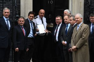 Danny Kinahan, the former Ulster Unionist Party MP and ex guardsman, third from right, joins Tory MPs last month to hand in a petition to 10 Downing Street signed by 104 MPs and peers and senior ex military figures calling for lasting legal protection for Northern Ireland veterans Photo: Kirsty O'Connor/PA Wire