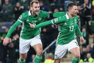 Niall McGinn (left) with Corry Evans following Northern Ireland's equaliser against Austria. Pic by INPHO.