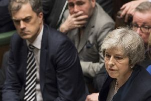 Chief whip Julian Smith, left, looks on as the Prime Minister Theresa May speaks in the crowded House of Commons in London after losing a vote on her Brexit plan on Tuesday. Moments earlier, he had bent over Mrs May's ear to inform her of the disastrous defeat. Photo: UK Parliament/Mark Duffy/PA Wire