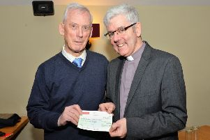 Rev Dr Ivan Hull presents a cheque for �200 on behalf of the Larne Tuesday Club to the Very Rev Stephen Forde, Dean of St Anne's Cathedral Belfast, for his Black Santa Appeal. INLT 02-002-PSB