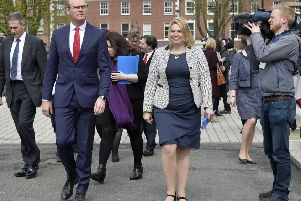 The Irish T�naiste, Simon Coveney, left, and the'' Secretary of State Karen Bradley MP at Queen's University Belfast in 2018, the 20th anniversary of the Belfast Agreement. Dublin is often partisan on behalf of nationalists in the Stormont talks, London mostly neutral