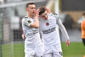 Crusaders' Paul Heatley celebrates with Ronan Hale, after the striker scored at the Brandywell.