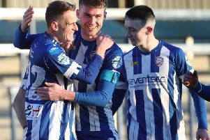 Dean Shiels celebrates his goal with Stevie Lowry and Mark Edgar