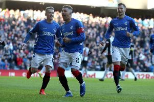 Rangers' James Taverrnier celebrates scoring his side's first goal of the game. Photo credit: Andrew Milligan/PA Wire