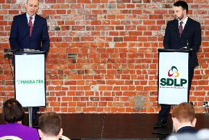 Fianna Fail and SDLP leaders Micheal Martin and Colum Eastwood in Belfast earlier this year. Some SDLP members dislike the new partnership between the parties